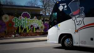 Barons Bus parked in front of Big Spring sign