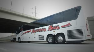 Barons Bus driving under overpass with low angle