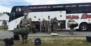 barons bus government military charter men unpacking equipment