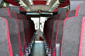 barons bus interior gray seats with red lining