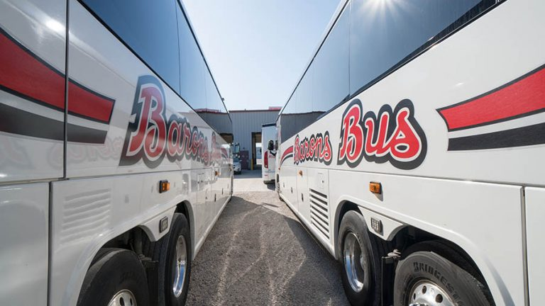 barons bus our fleet exterior two buses perspective converging